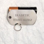 "Dog tag used as medical ID with ""Diabetic"" on the first line and ""Tetanus Allergy"" on the second."