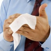 Homemade Antibacterial Wipes, A man cleaning his hands with an antibacterial wipe.