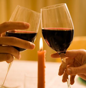 Valentine's Day Dinner Ideas, A romantic candlelit dinner for two with wineglasses.