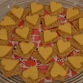 Heart Shaped Foods For Valentine's Day, A platter of heart shaped cheese slices