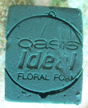 Imprint of bucket on foam.