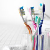 Sanitizing Your Toothbrush, Glass container of toothbrushes.