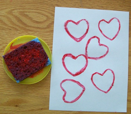 Red inked sponge and stamped paper.