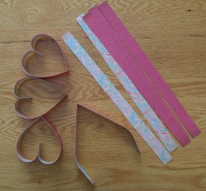 Strips of paper and heart shapes.