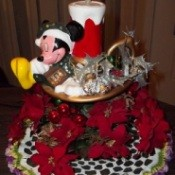 Repairing an old Mickey Christmas sculpture.