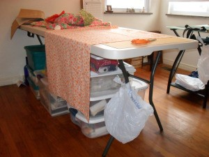 A sewing room garbage can by tying a bag to the table leg.