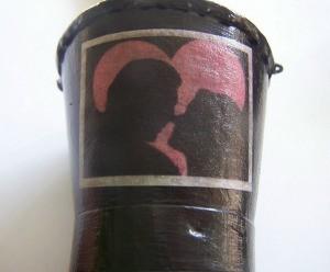 Illustration glued on outside of bucket.
