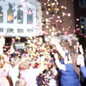 Flower petals being thrown at a wedding.