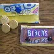 Two small pouches made from candy or cookie wrappers.