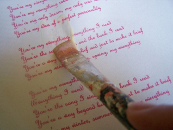 Paint Paper Seal over the printout of the lyrics