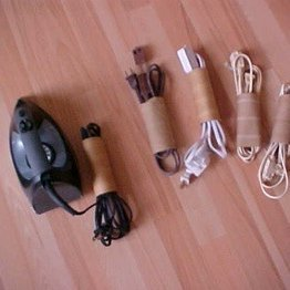 Storing appliance cords in toilet paper tubes to keep from tangling.