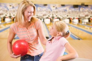 Learning How to Bowl, Mother and Daughter at Bowling Alley