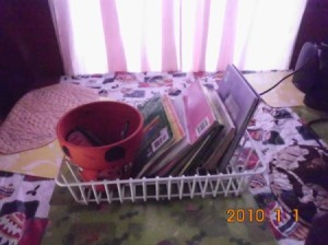 A dish drainer used for organizing a desk.