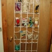 An over the door organizer filled with craft supplies.