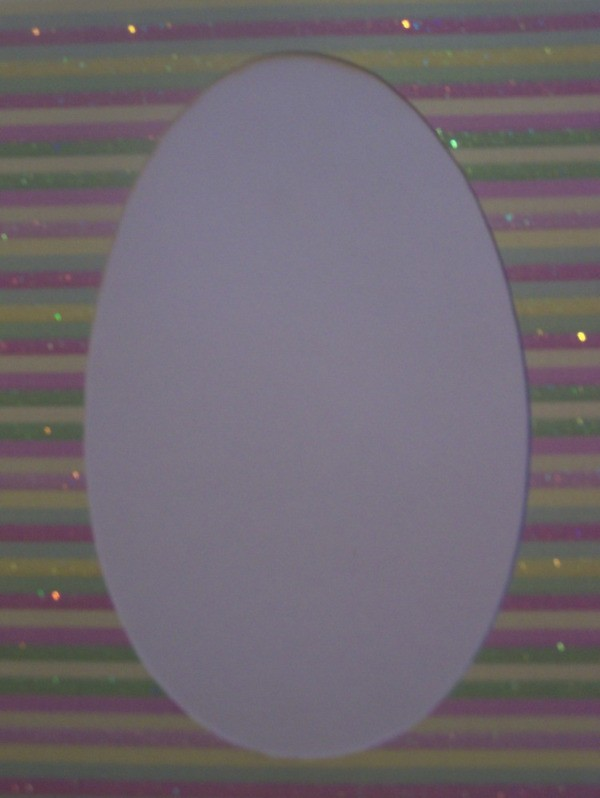Spring is here card - Trace egg onto striped cardboard and cut out.