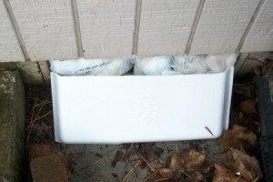 Makeshift Vent Hole Covers - Plastic bags and styrofoam as a better weatherproofing.