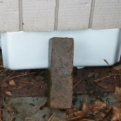 Makeshift Vent Hole Covers - Plastic bags and styrofoam with a brick holding it in place.
