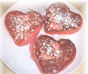 Pink heart shaped pancakes.