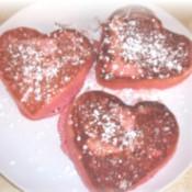 Pink heart shaped pancakes.