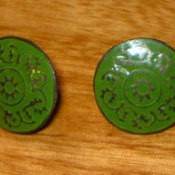 Two vintage buttons.