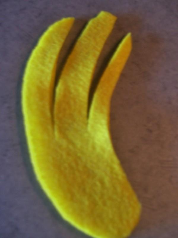 Cut felt banana peel.