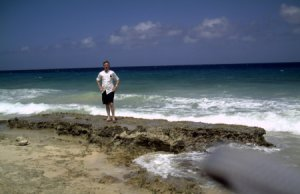 Christiansted (St.Croix, US Virgin Islands), man on ocean beach.