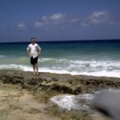 Christiansted (St.Croix, US Virgin Islands), man on ocean beach.