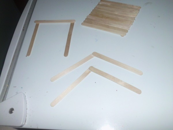 Gluing roof sections and 45 degree angle pieces.
