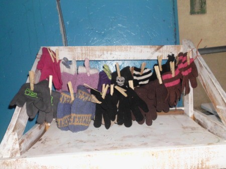 Hang Mittens In Pairs, on string or twine.