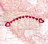 Heart stickers showing distance on a map.