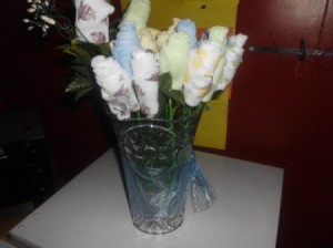 Vase of washcloth flowers.