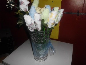 Vase of washcloth flowers.