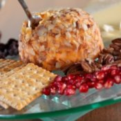 Cheese ball on plate with crackers and berries