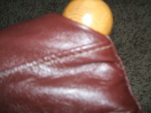 Leather Jacket Footstool - Turning and fitting the leather around the top of the legs.