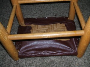 Leather Jacket Footstool - Stapling leather to underside.
