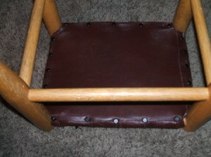 Leather Jacket Footstool - Covering the center of the underside with the final piece of leather.