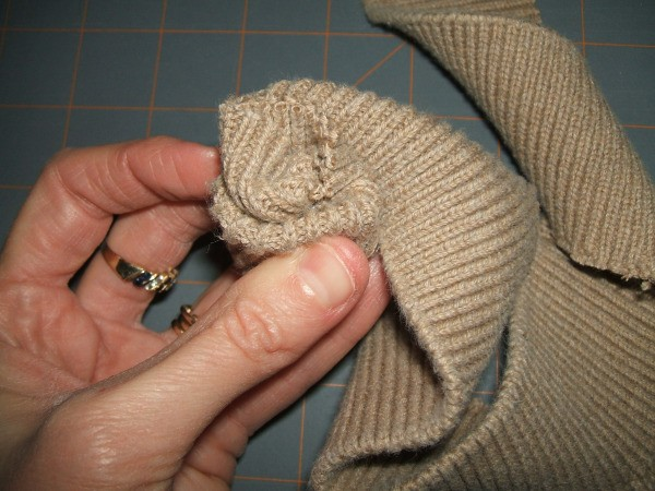 Rolling and twisting band to form rose.