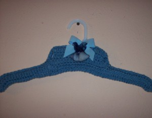 Blue crocheted clothes hanger.