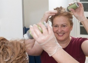 A woman dying her hair