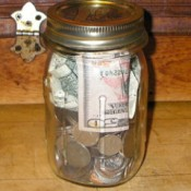 Saving money in a jar.