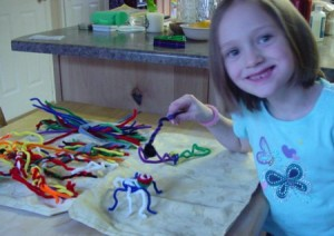 Pipe Cleaner Play Case - Child building pipe cleaner bugs, etc.