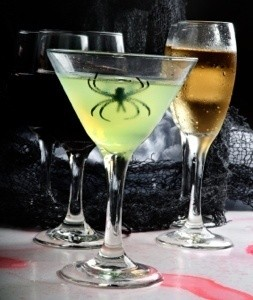 a glowing drink with a spider inside it - Halloween Monster Trivia