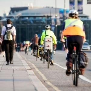 Several people commuting by bike.