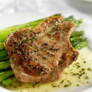 Seasoned pork chop on asparagus
