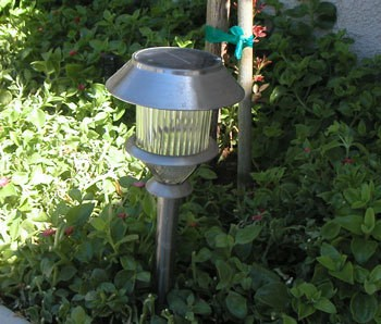Attach Solar Lights to Your Fence - Solar light stuck in the ground.