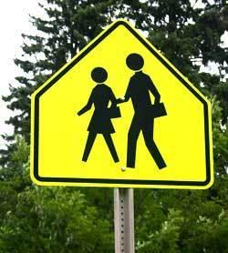 Yellow crosswalk sign.