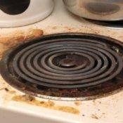 Dirty drip pan and stove top.