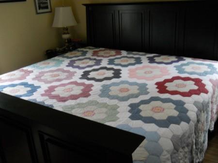 Flower Garden Quilt on bed.