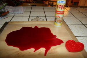 Recycled Candle Wax Air Freshener - Melted wax on Pam sprayed wax paper.