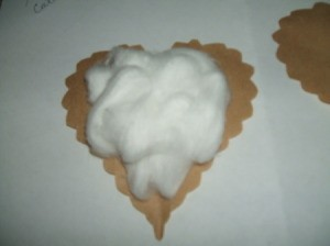 Cotton ball stuffing on one heart.